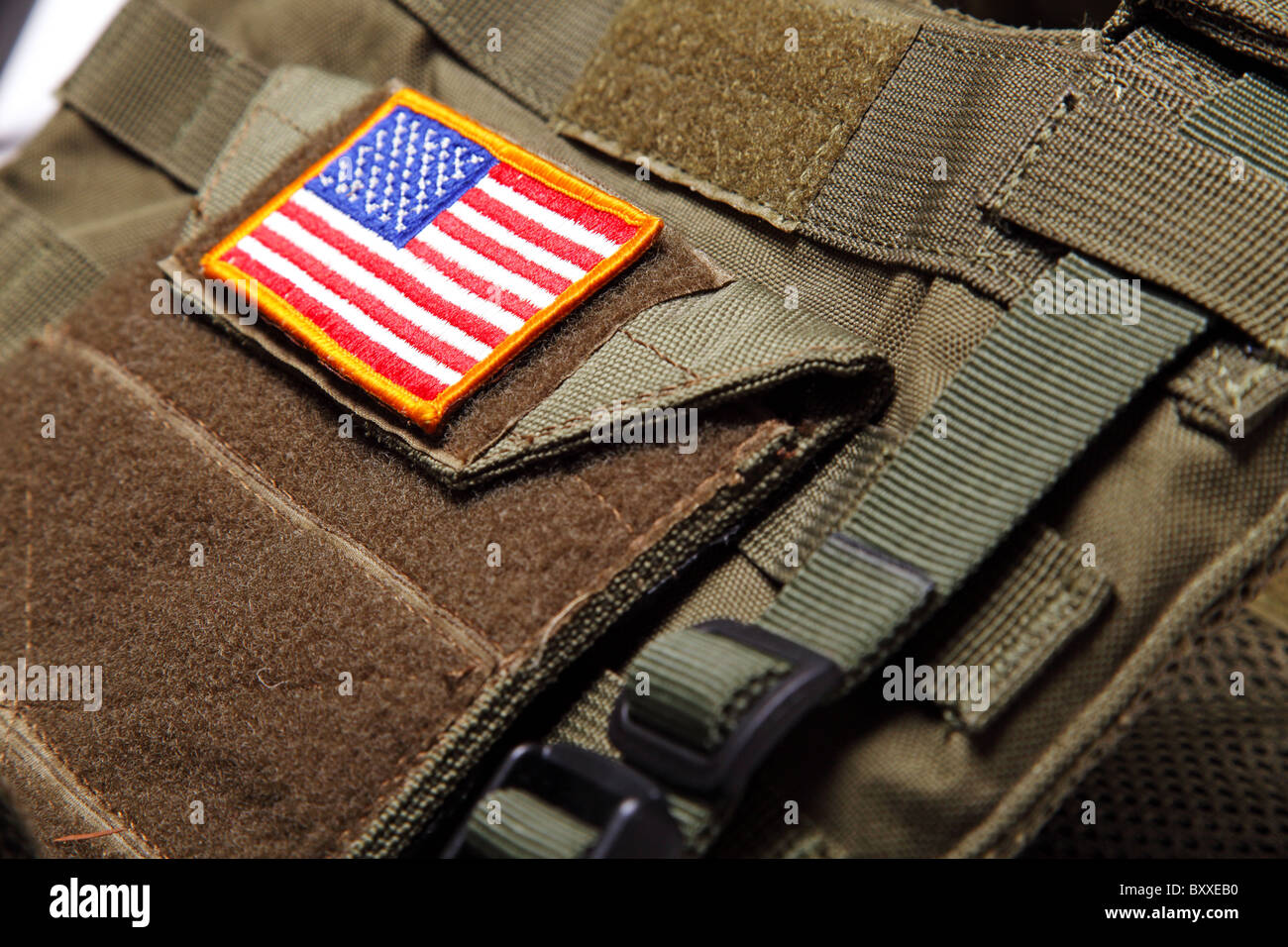 American flag on a green (olive drab) tactical vest. Close-up. - Stock Image