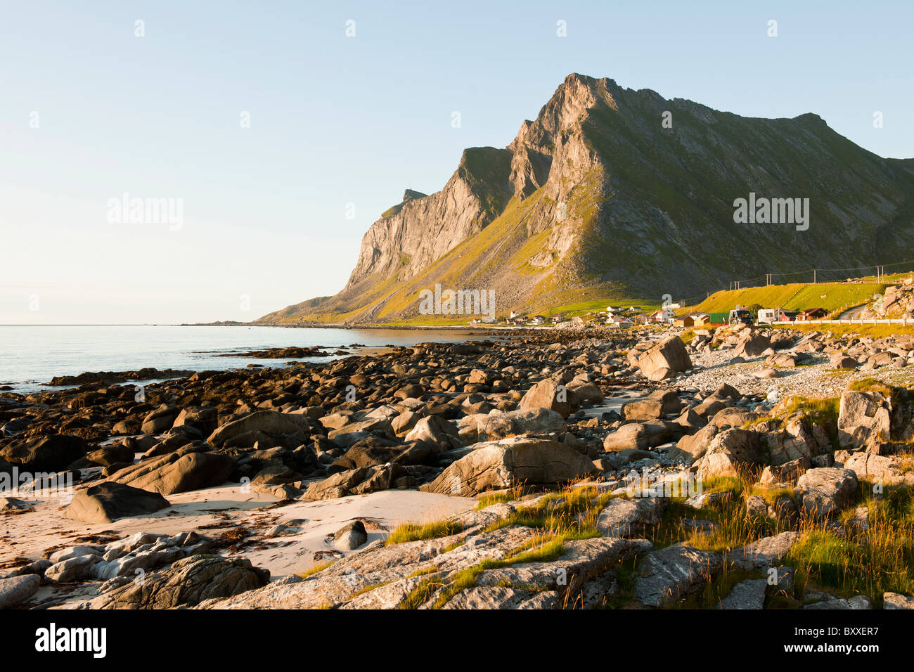 Low evening sun over the village Vikten by the open sea in Lofoten, North Norway - Stock Image