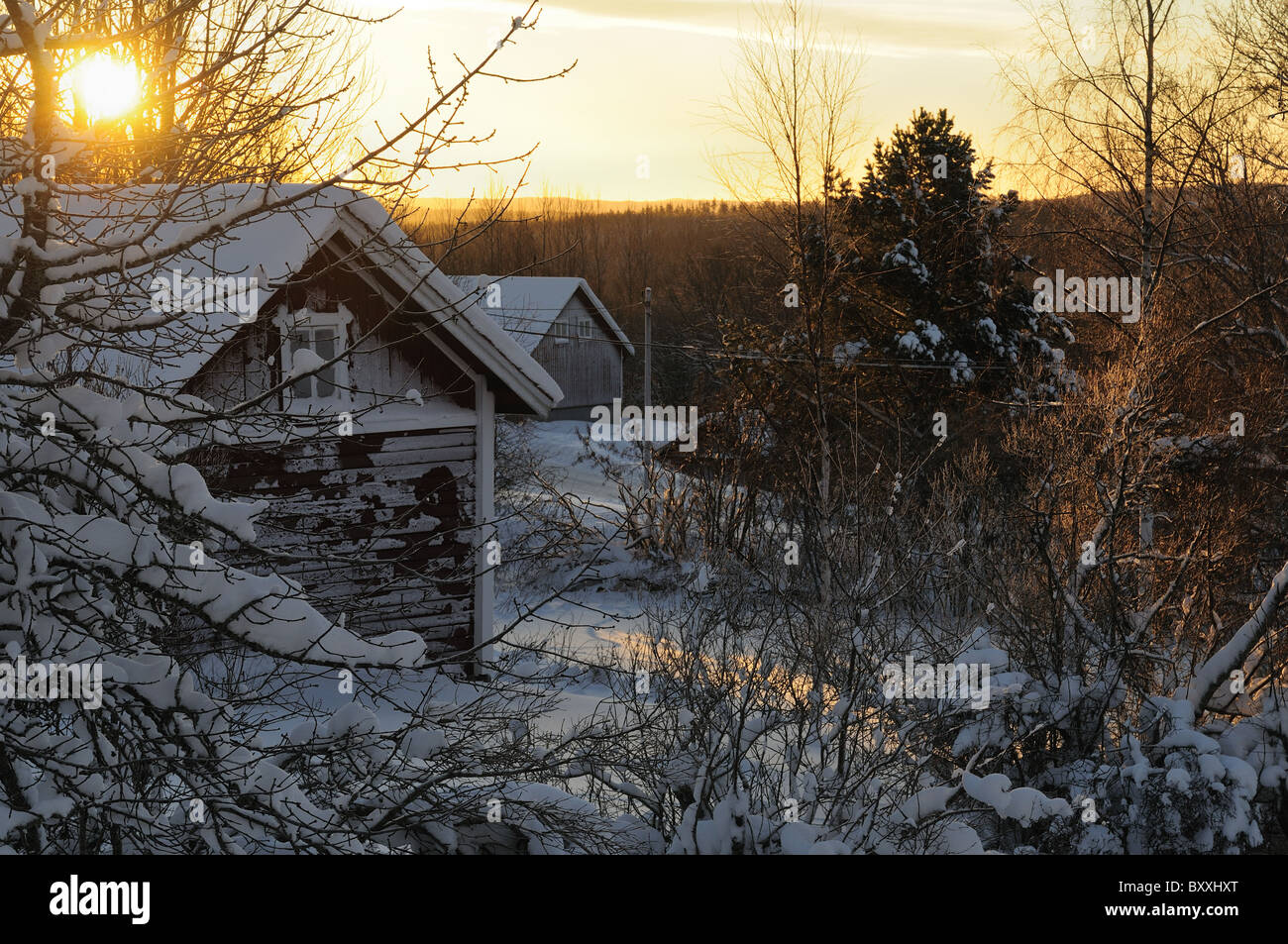 The old and abandoned hut at sunrise on the winter in Vintjarn in Central Sweden - Stock Image