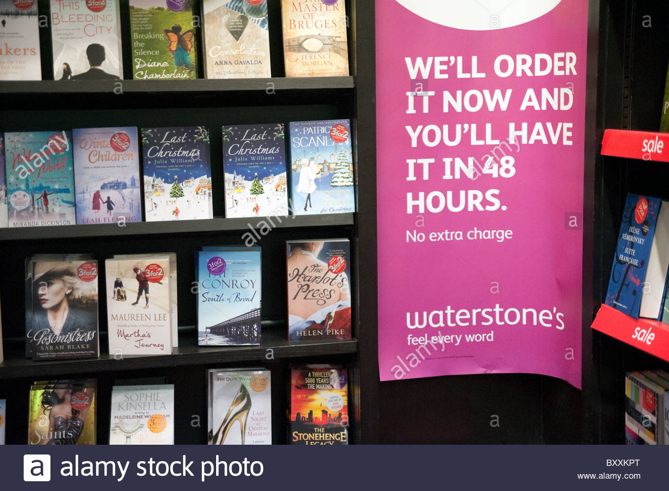 Paperback books for sale inside a Waterstone's bookshop, UK. - Stock Image