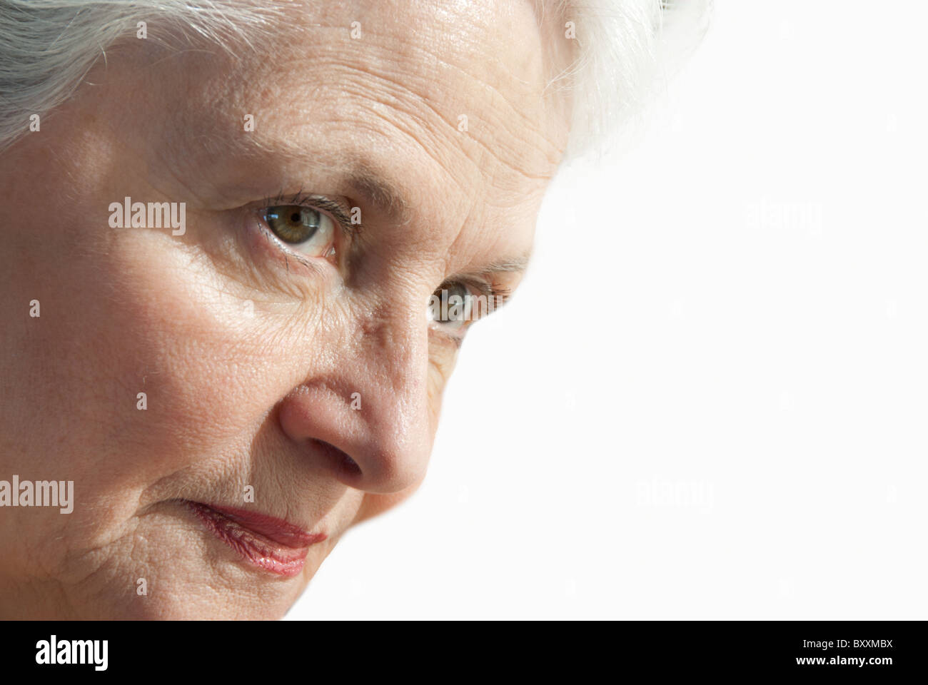 Senior woman intently looking Stock Photo