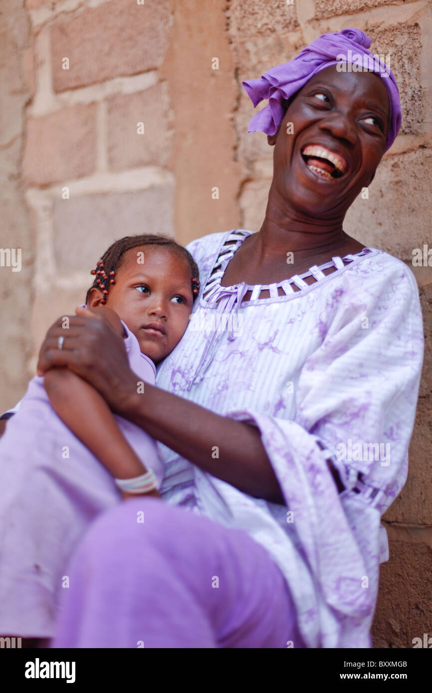 Mossi woman and child at a baptism in Ouagadougou, Burkina Faso. - Stock Image