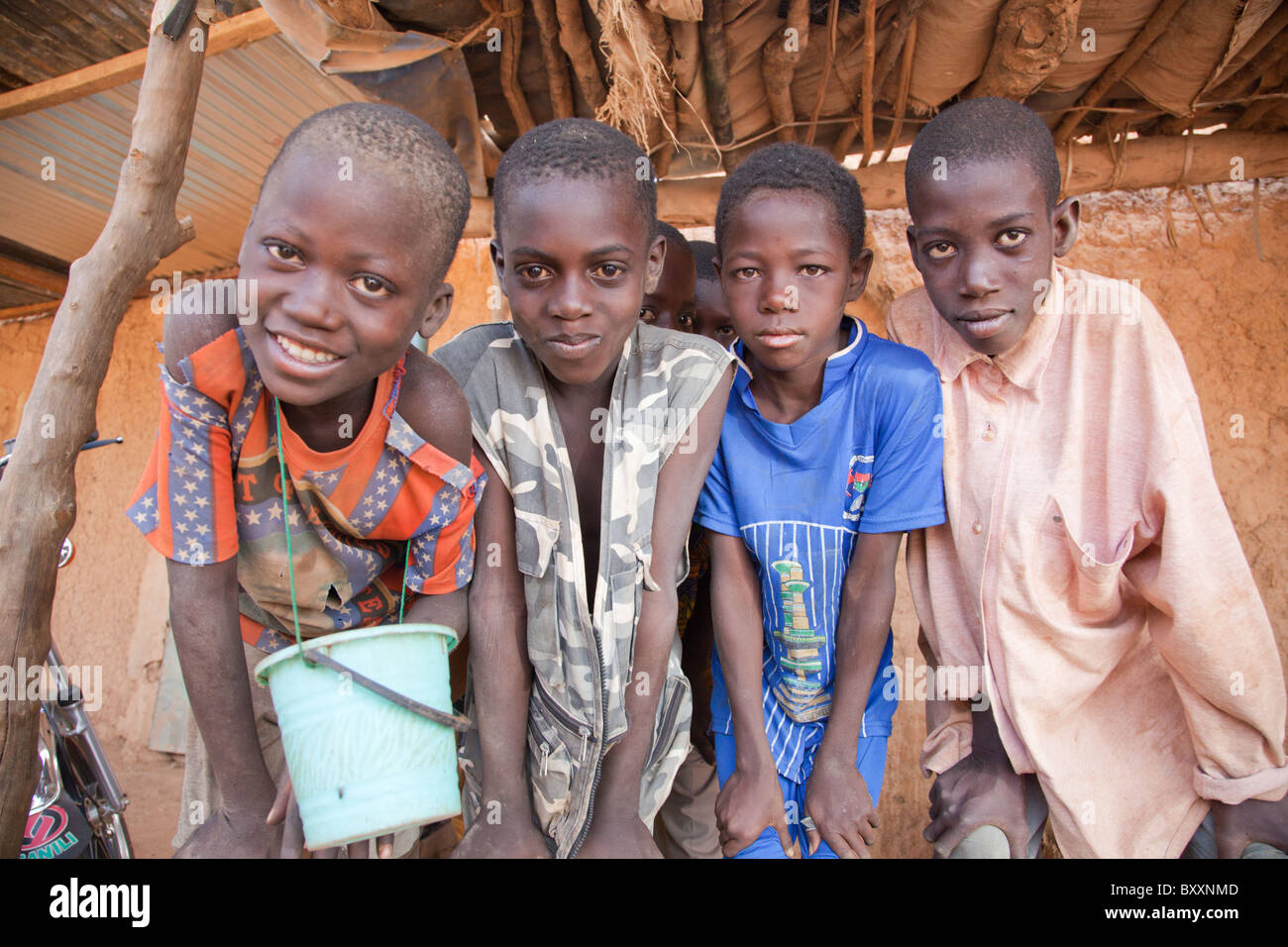 Quranic students roam the market in Djibo, northern Burkina Faso. It is tradition for these religious students to - Stock Image