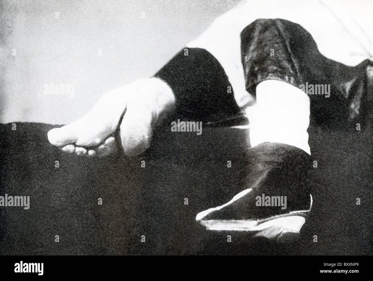 For centuries, many Chinese women observed the custom known as chanzu ('bound feet' *), shown here within - Stock Image