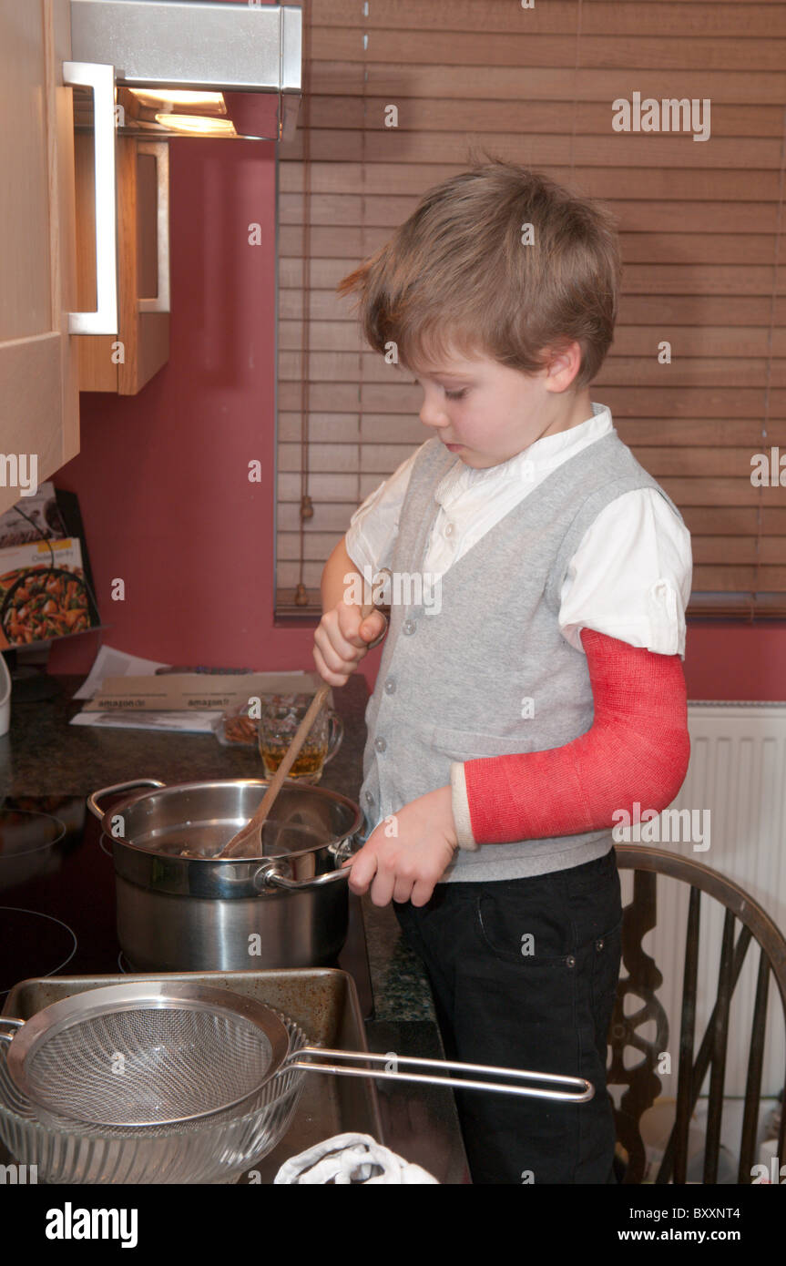 Four Year Two Year Community: Four-year-old Boy With A Broken Arm Cooking Making Cakes
