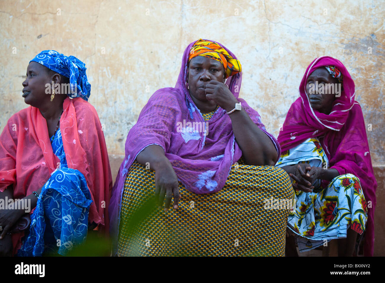 Fulani women attend a 'bantule' in northern Burkina Faso, when the bride moves into the groom's home. - Stock Image