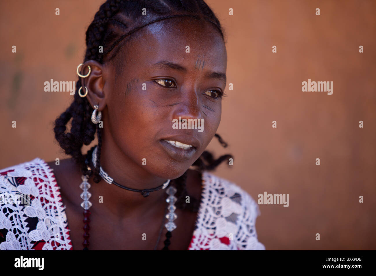 Fulani woman in Djibo in northern Burkina Faso. The woman sports the traditional facial scarring, that is considered - Stock Image