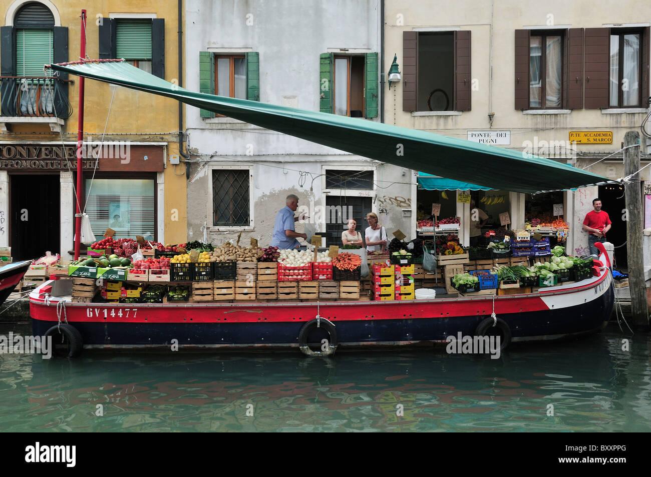 Venice. Italy. Fruit & Veg Barge on Rio San Barnaba / Piazza San Barnaba. - Stock Image