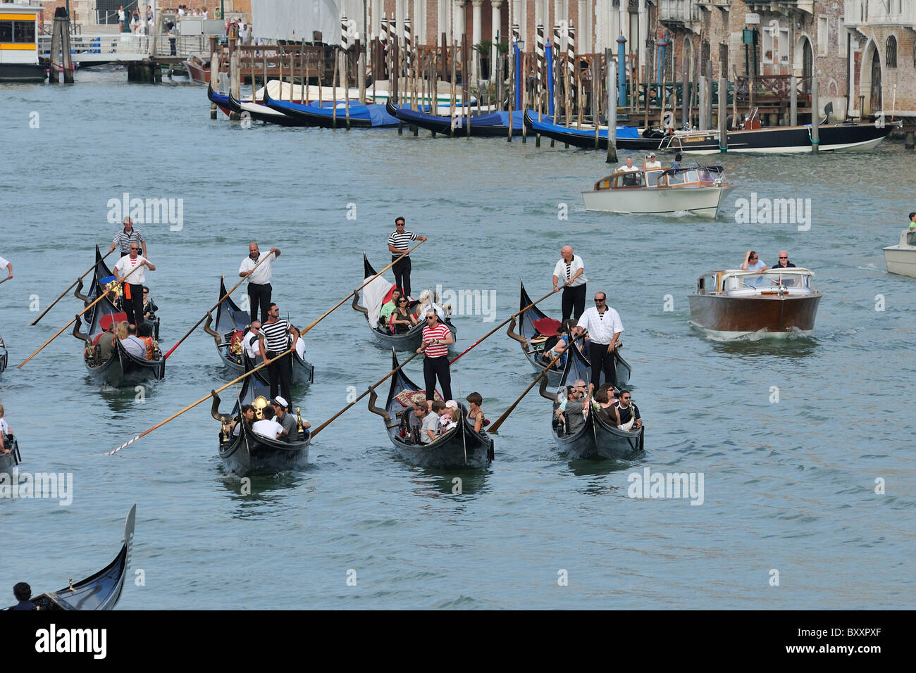 Venice. Italy. Groups of tourists in gondolas on the Grand Canal. - Stock Image