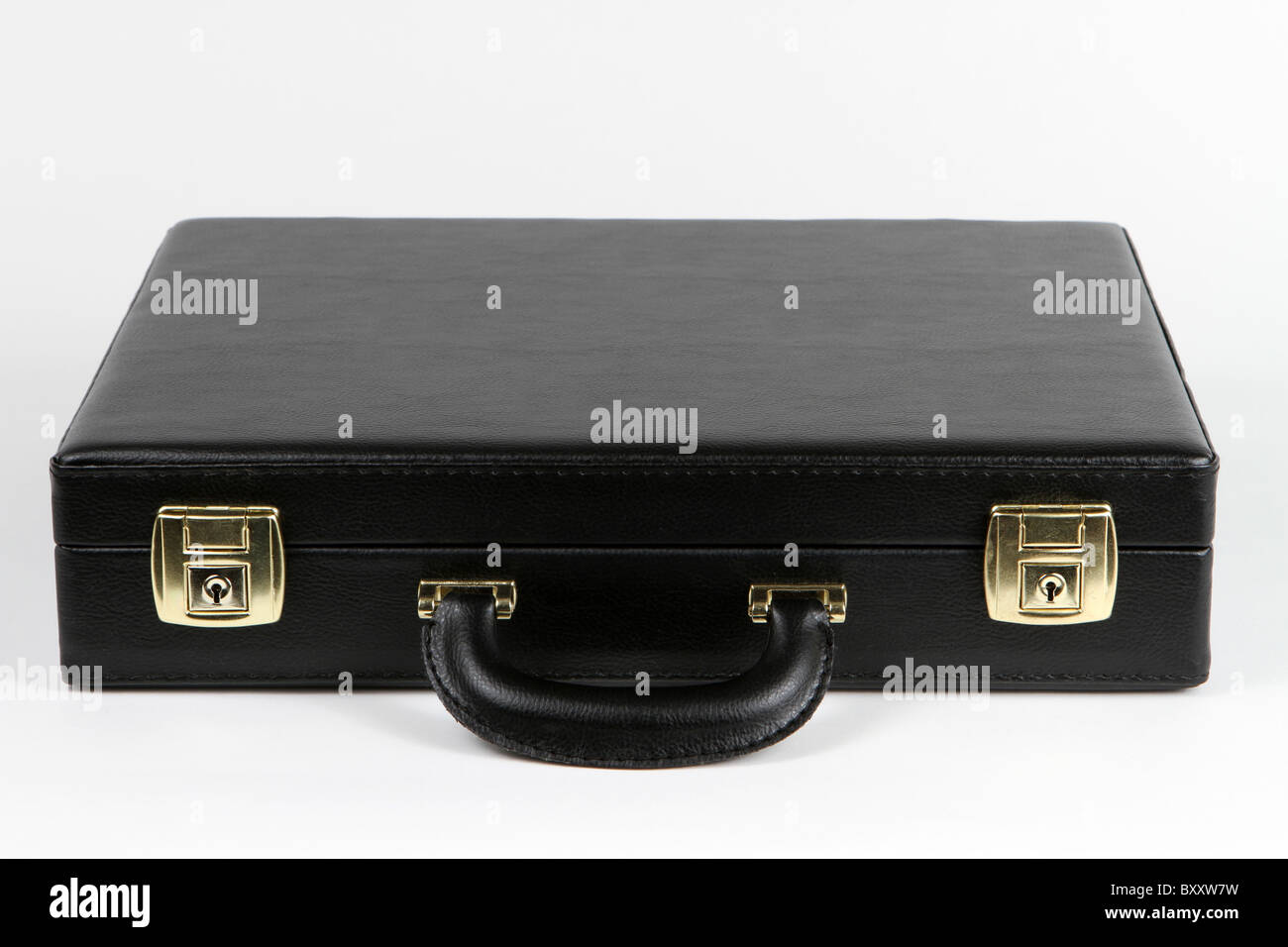 Black business briefcase with brass clasps and a handle. - Stock Image