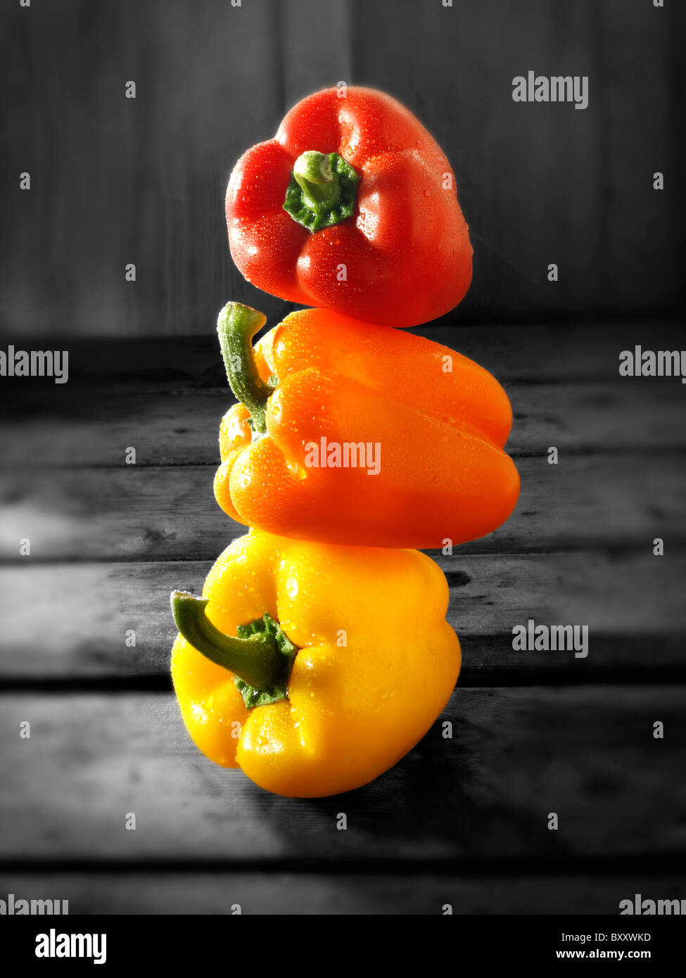 Mixed red, yellow & orange fresh bell peppers photos, pictures & images - Stock Image