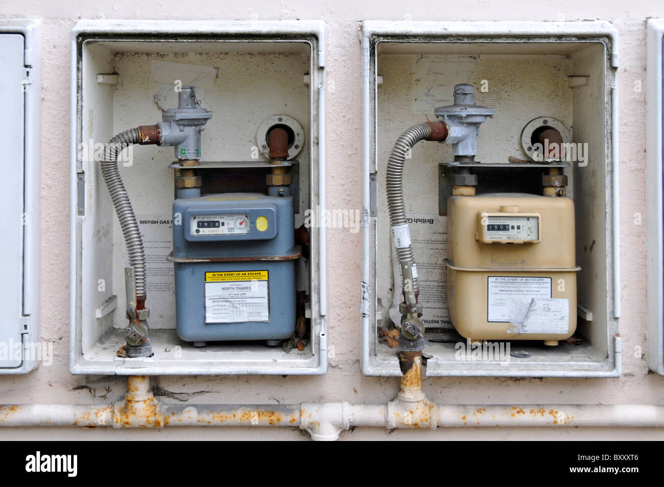 Gas meter cupboards without doors on external wall of block of flats - Stock Image