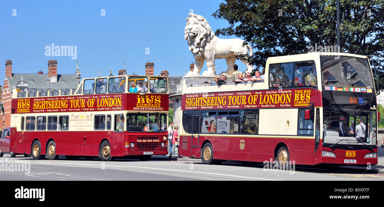 London street scene two open top sightseeing tour buses at bus stop on Westminster Bridge beside The South Bank - Stock Image