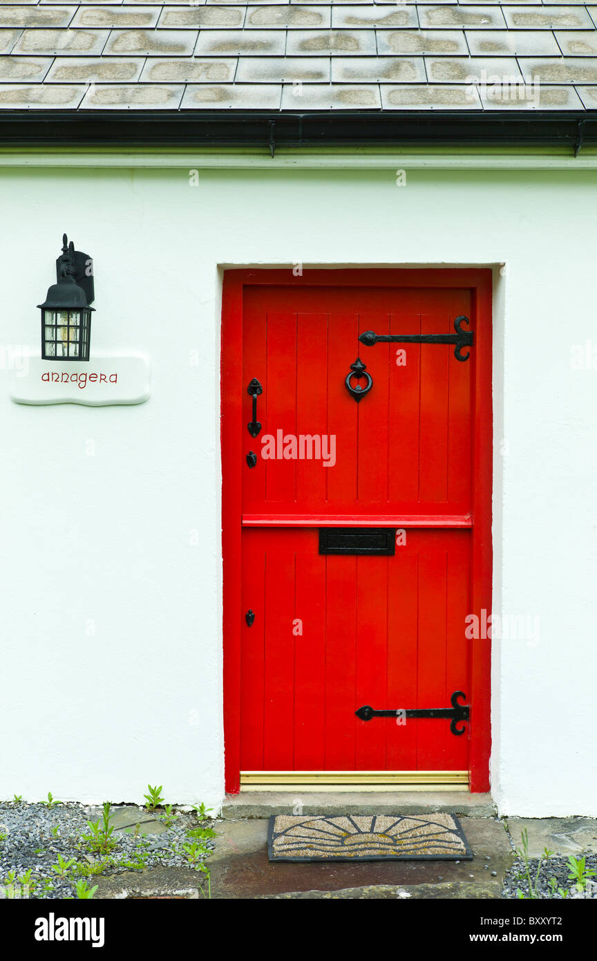 Front door in stable-door style on traditional whitewashed cottage ...
