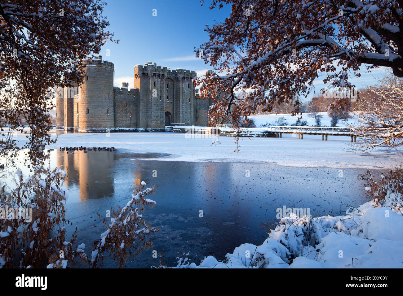 a cold, crisp winter's morning after fresh snowfall and minus 10 temperatures at beautiful Bodiam Castle in - Stock Image