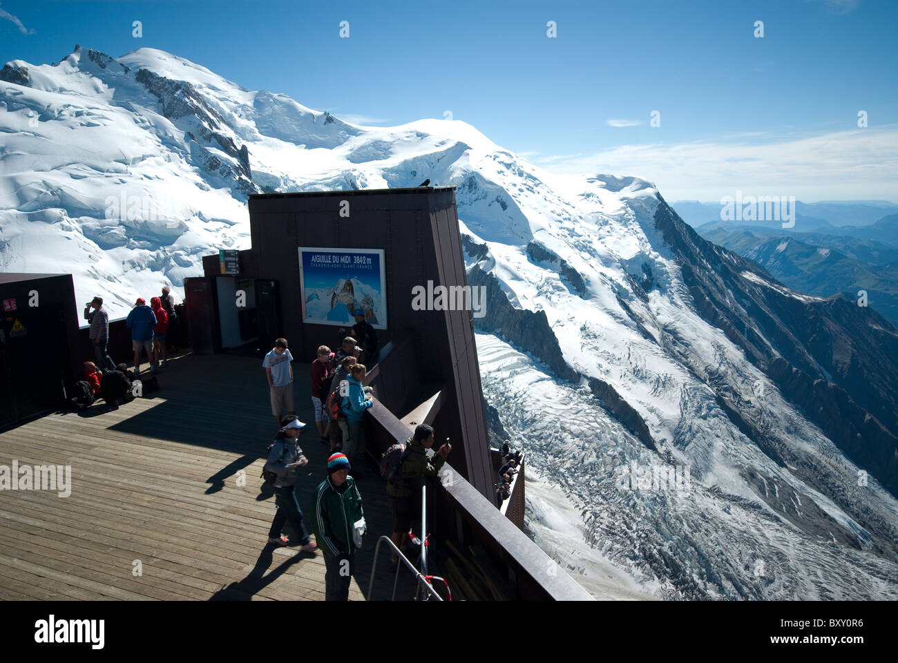 Aiguille du Midi viewing platform at 3842 m with Mont Maudit and Mont Blanc in the distance. Near Chamonix, French - Stock Image