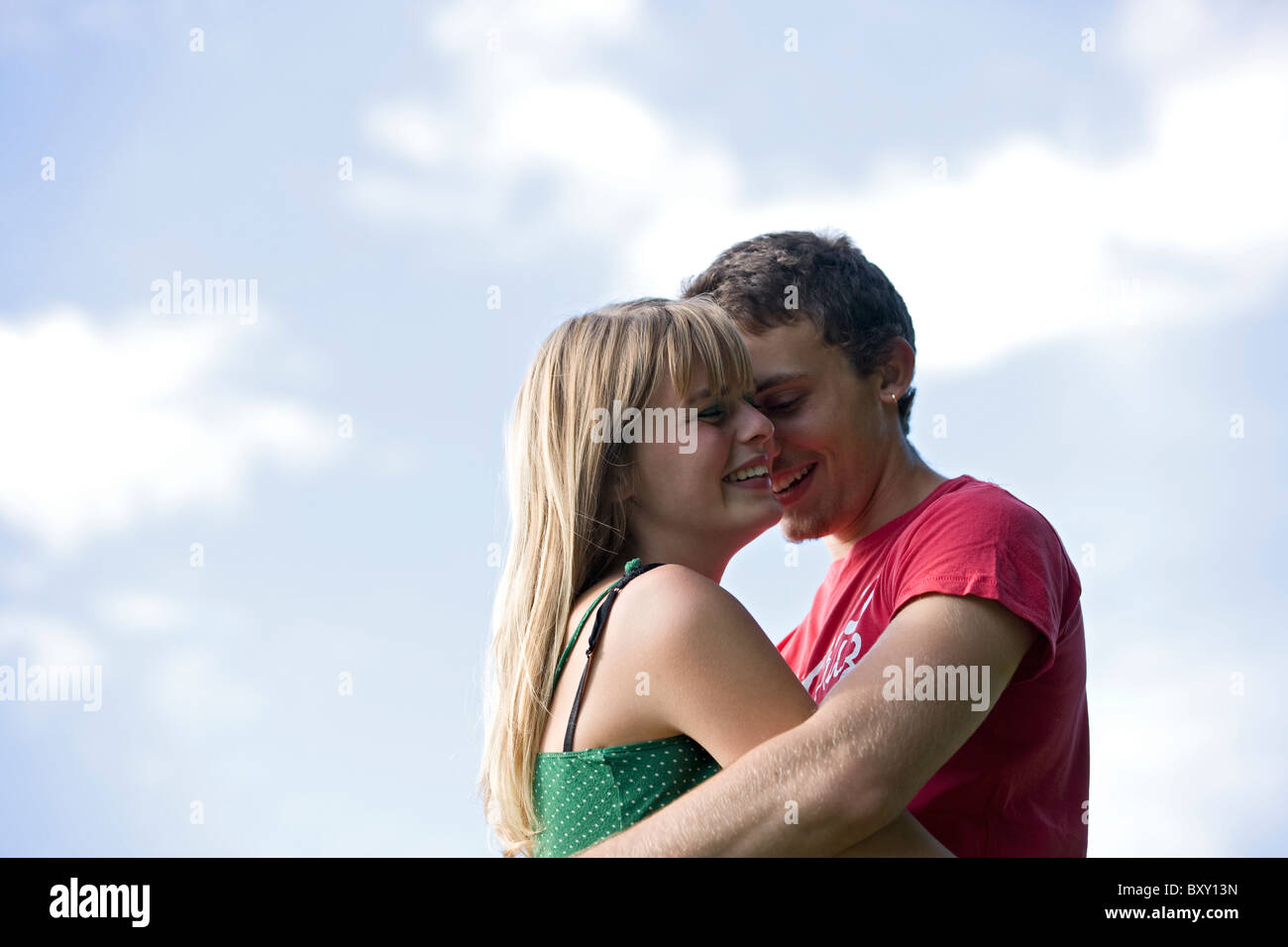 A romantic young couple embracing outdoors - Stock Image