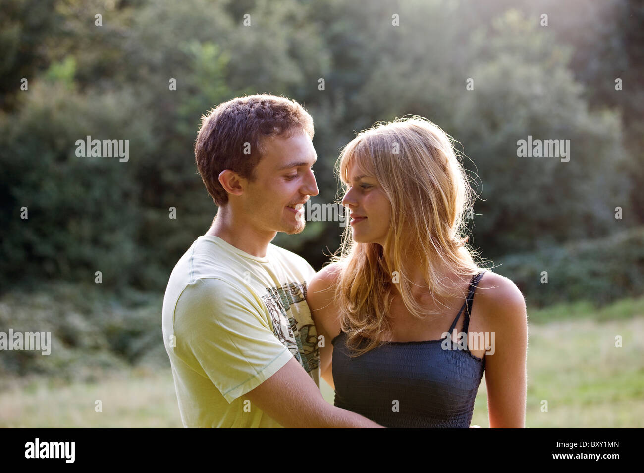 A romantic young couple standing outdoors - Stock Image