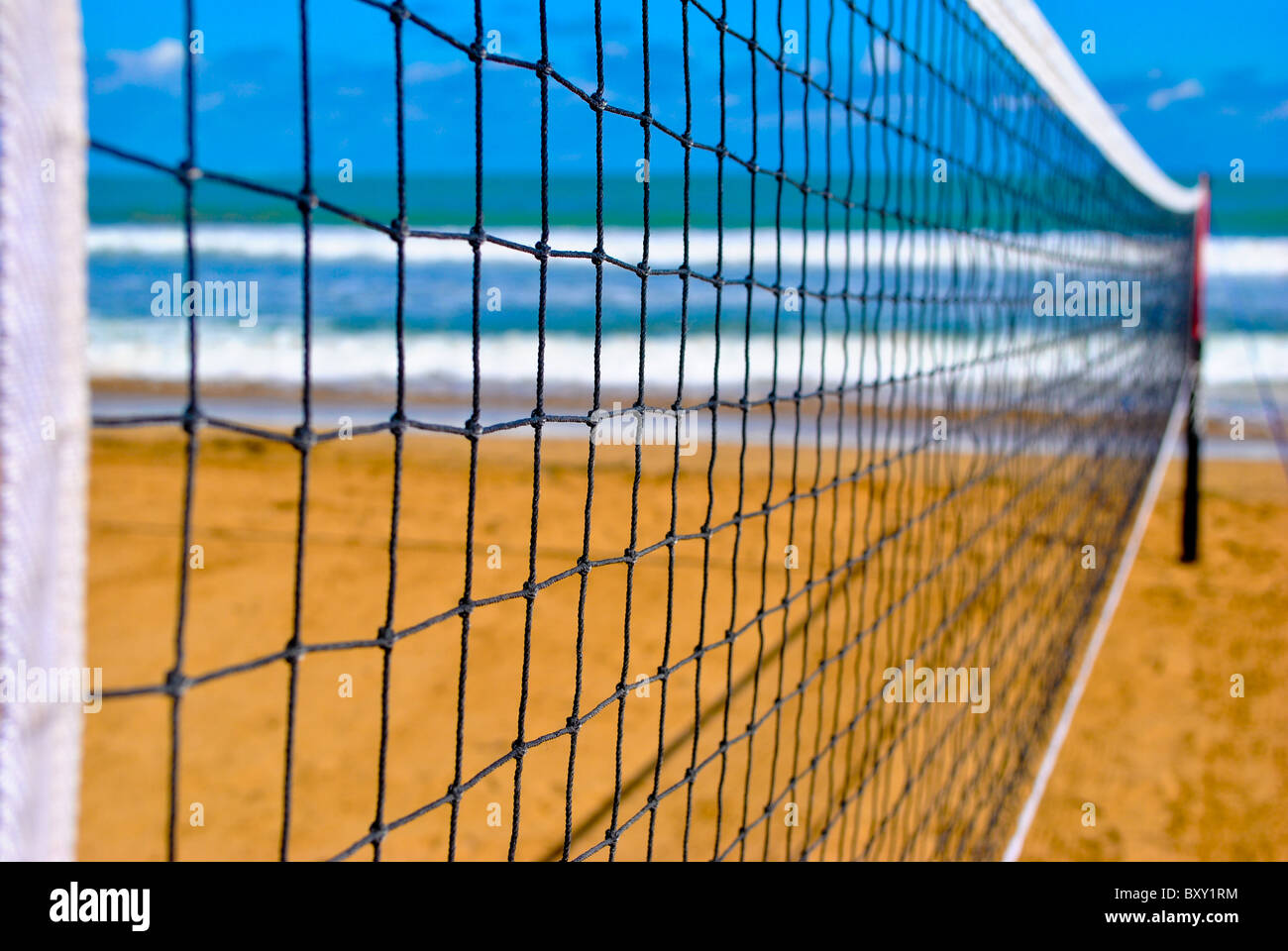 Volleyball net near the ocean. - Stock Image