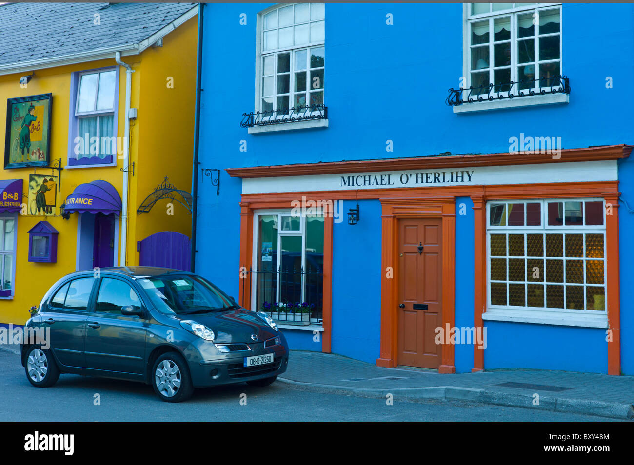 Street scene of traditional brightly coloured properties in Kinsale, County Cork, Ireland - Stock Image