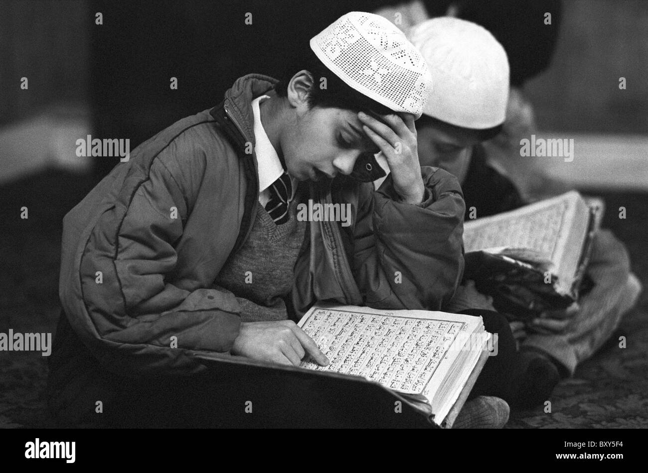 Moslem boys of Pakistani origin studying the Koran at a religious school in Bradford - Stock Image