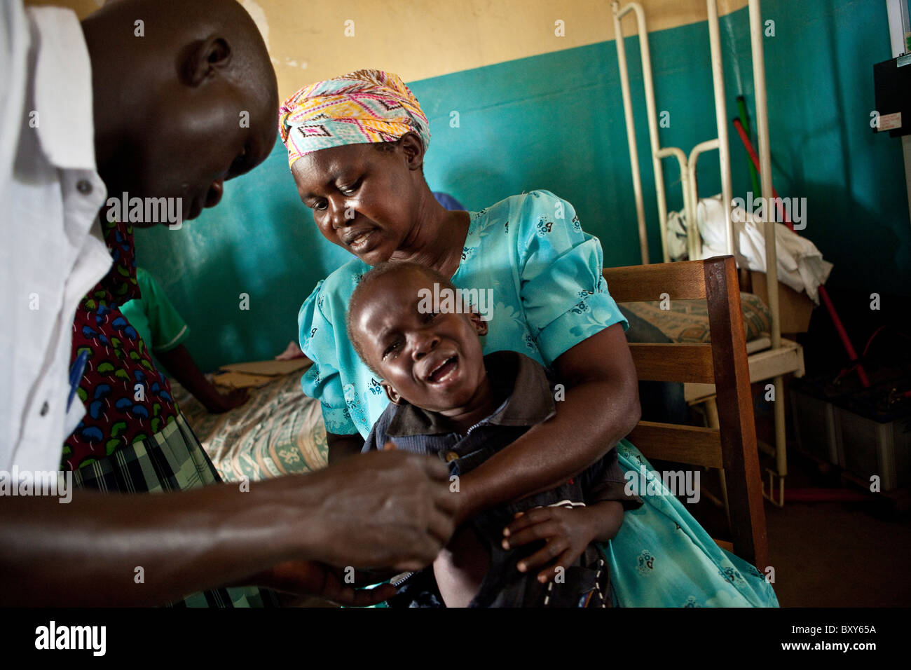A child receives an injection at Amuria Health Centre IV - Amuria District, Uganda, East Africa. Stock Photo