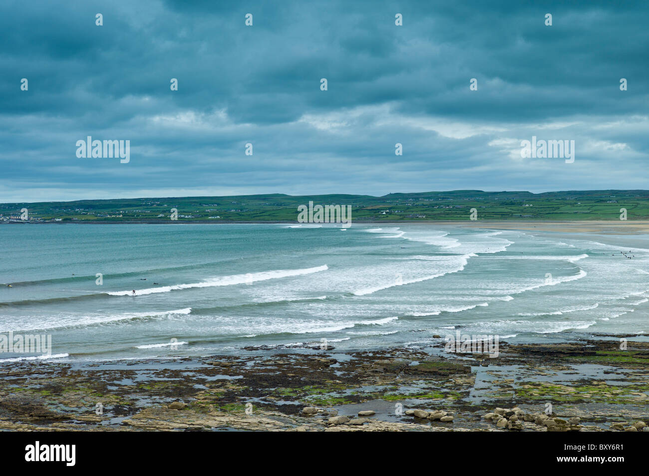 Beach and waves at Lahinch (Lehinch) famous surfing beach in County Clare, West Coast of Ireland - Stock Image