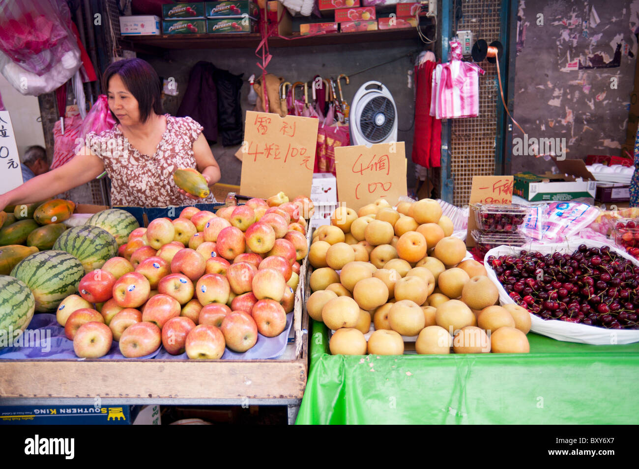 A fruit seller at a fruit market in central Taipei stands behind a