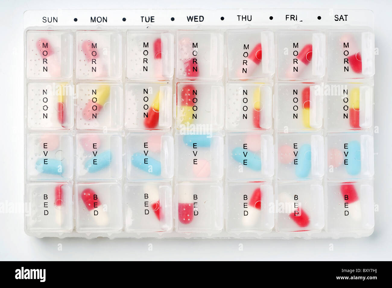 a week pill organizer on white - Stock Image
