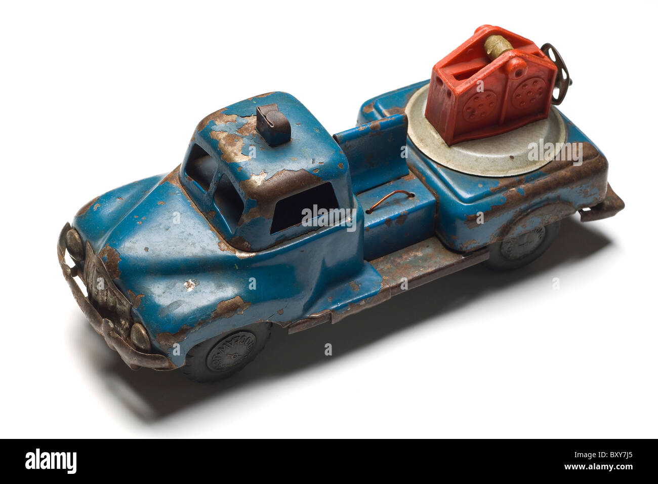 an old rusty toy tow truck on white - Stock Image