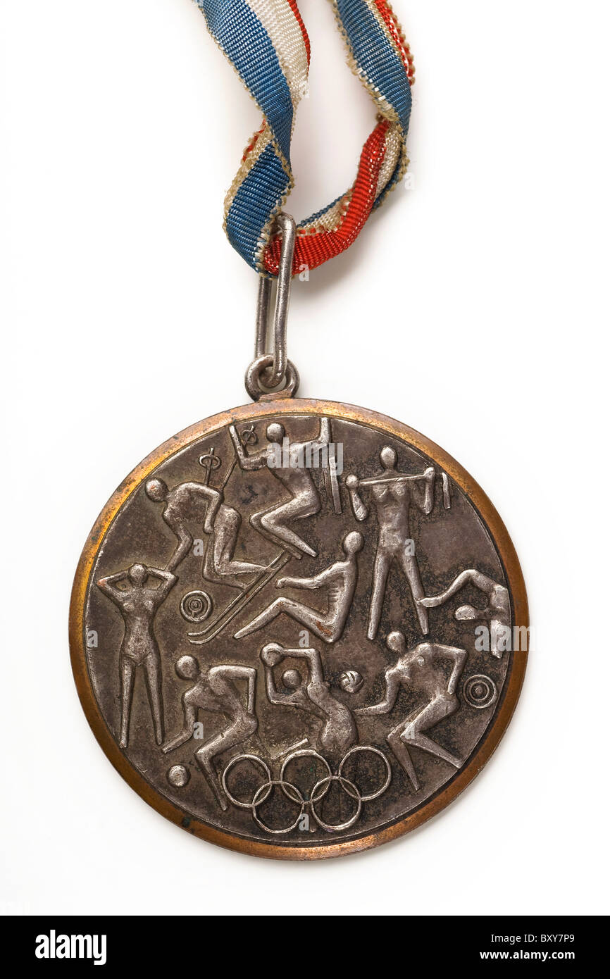 a closeup of an old olympic bronze medal on white - Stock Image