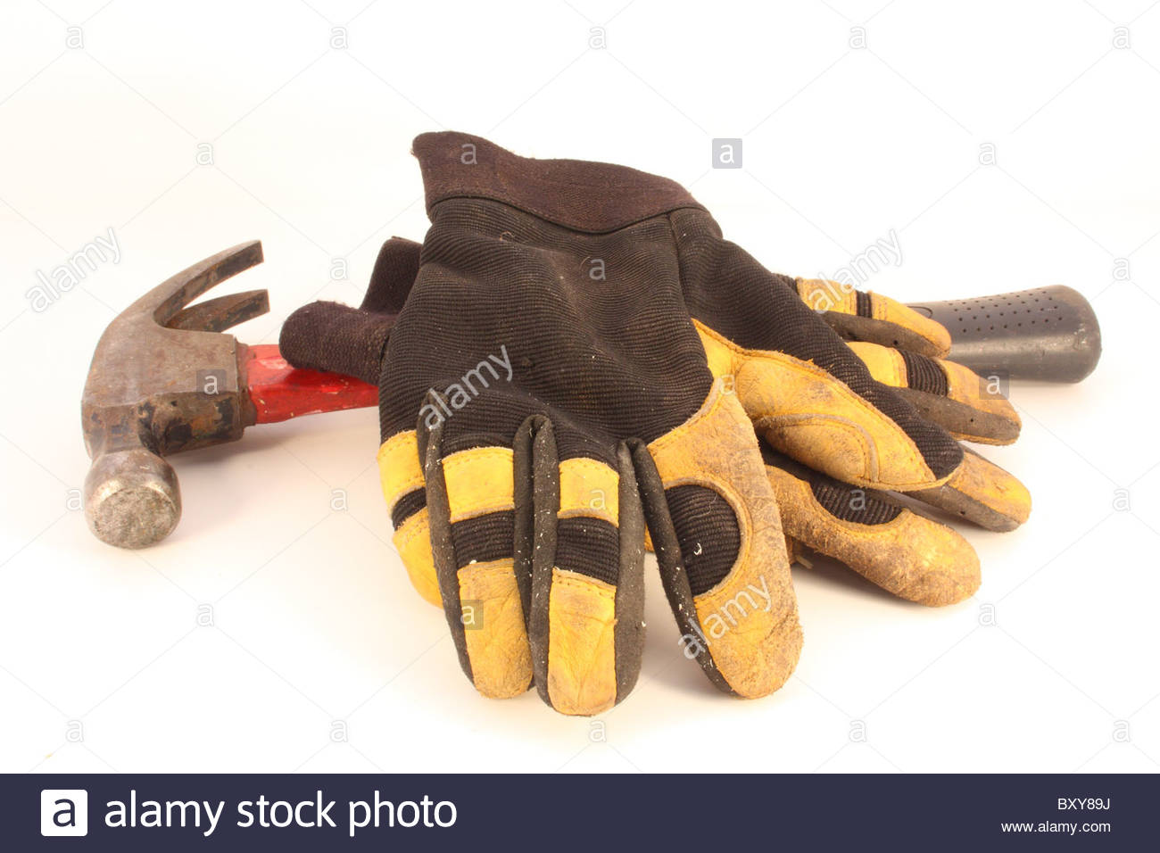 leather work gloves with claw hammer - Stock Image
