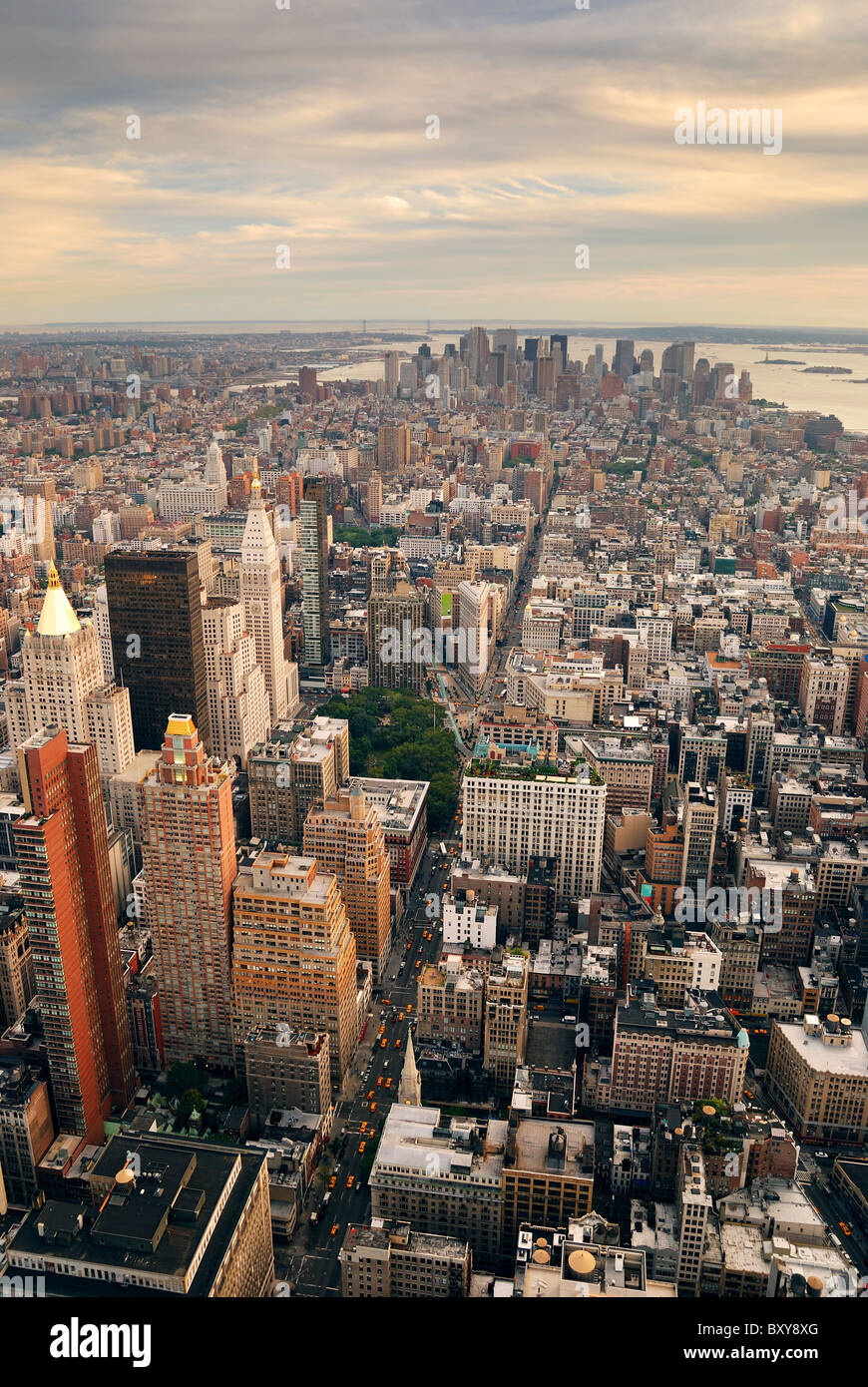 New York City Manhattan sunset skyline aerial view with office building skyscrapers and Hudson River. - Stock Image