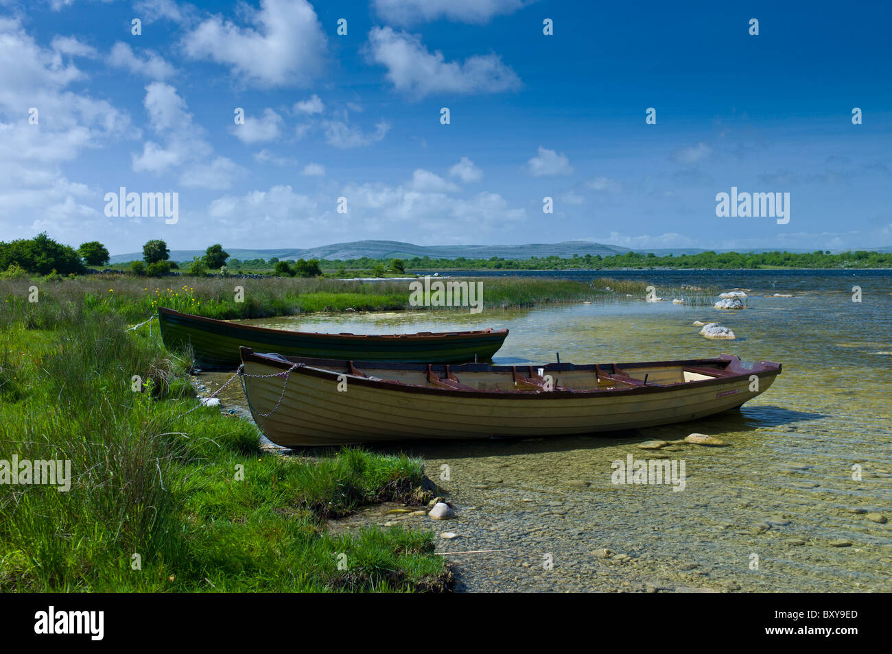 Boats among the reeds at Lough Muckanagh, County Clare, West of Ireland - Stock Image