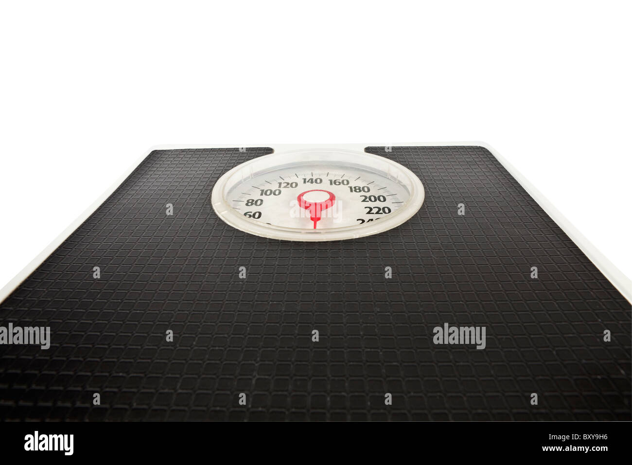 Old bathroom scale looms large with news of holiday weight gain. - Stock Image