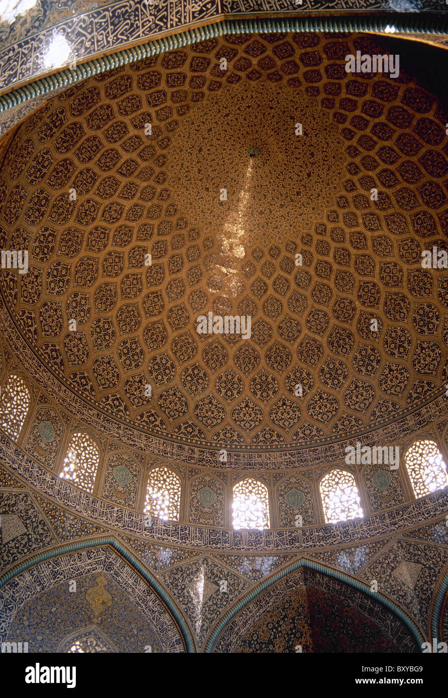 Sheikh Loftollah Mosque. Dome of the prayer hall covered with glazed tiles and writing of Ali Reza Abbasi. Isfahan. - Stock Image