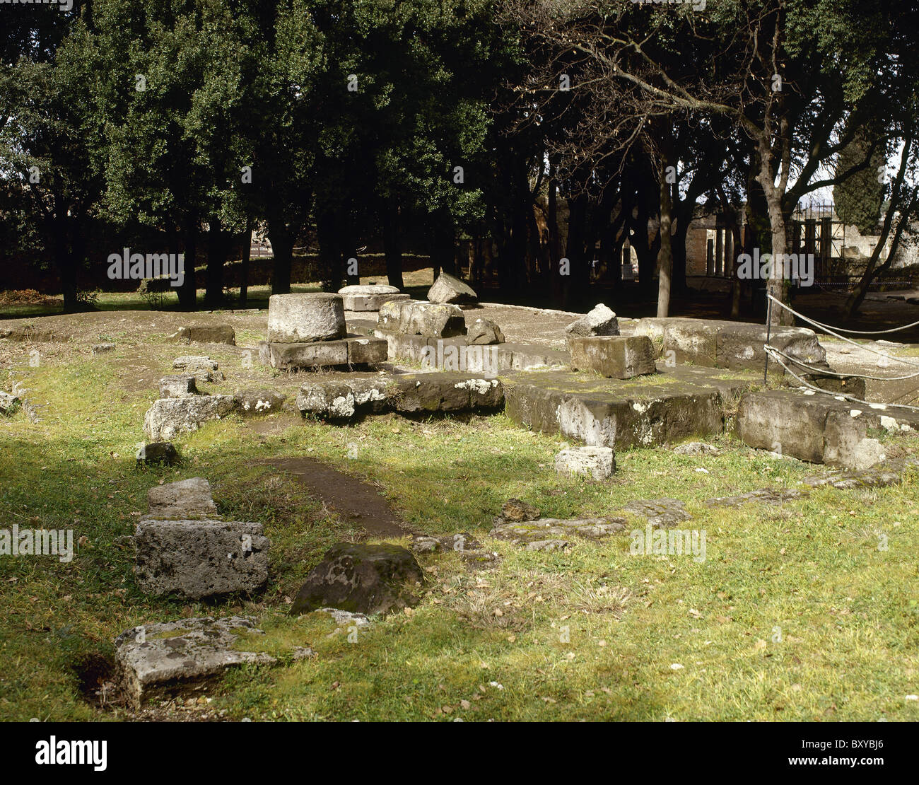 Pompeii. Triangular Forum. Doric temple ruins. Foundations and fragments of the pillar in the temple. Italy. - Stock Image