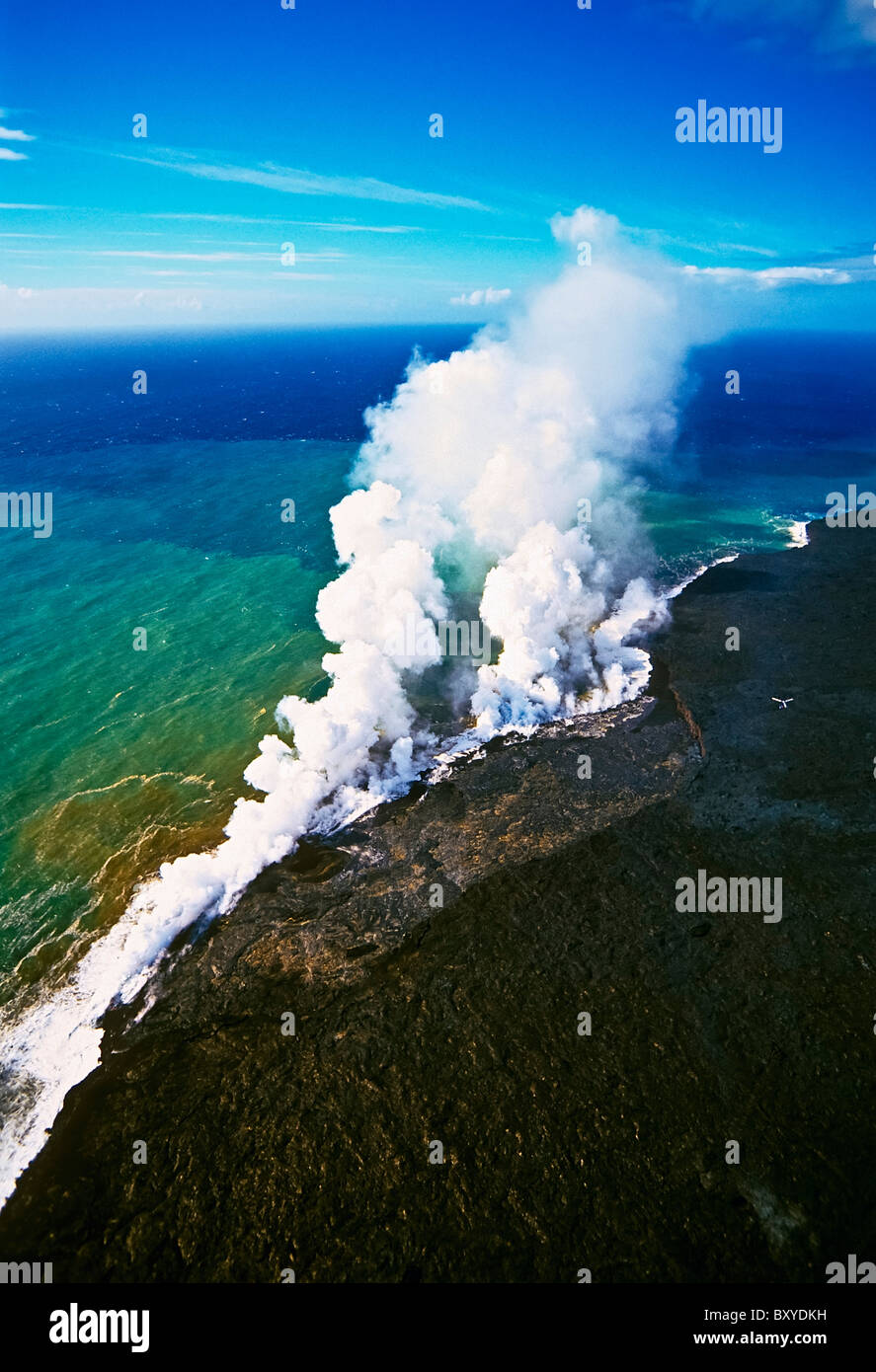 Molten Lava enters cold Ocean, Kilauea Volcano, Big Island, Hawaii, USA - Stock Image