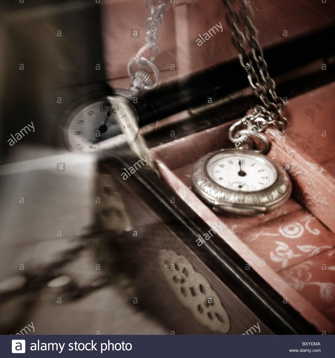 Ornamental timepiece in jewelry box - Stock Image