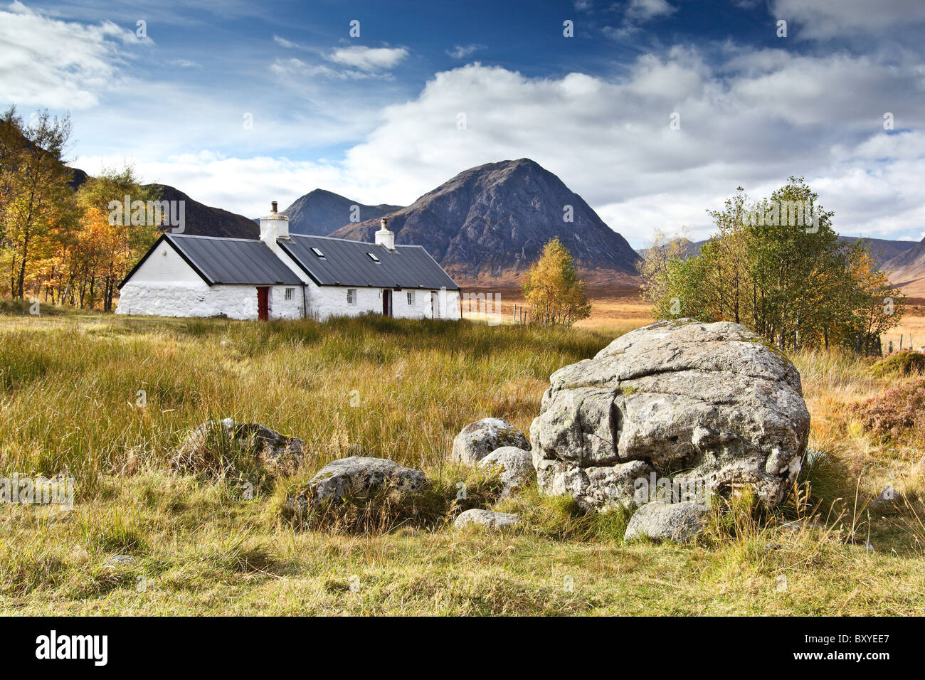 Blackrock cottage in Autumn with Stob Dearg and Buachaille Etive Mor in background, Rannoch Moor, near Glencoe, - Stock Image