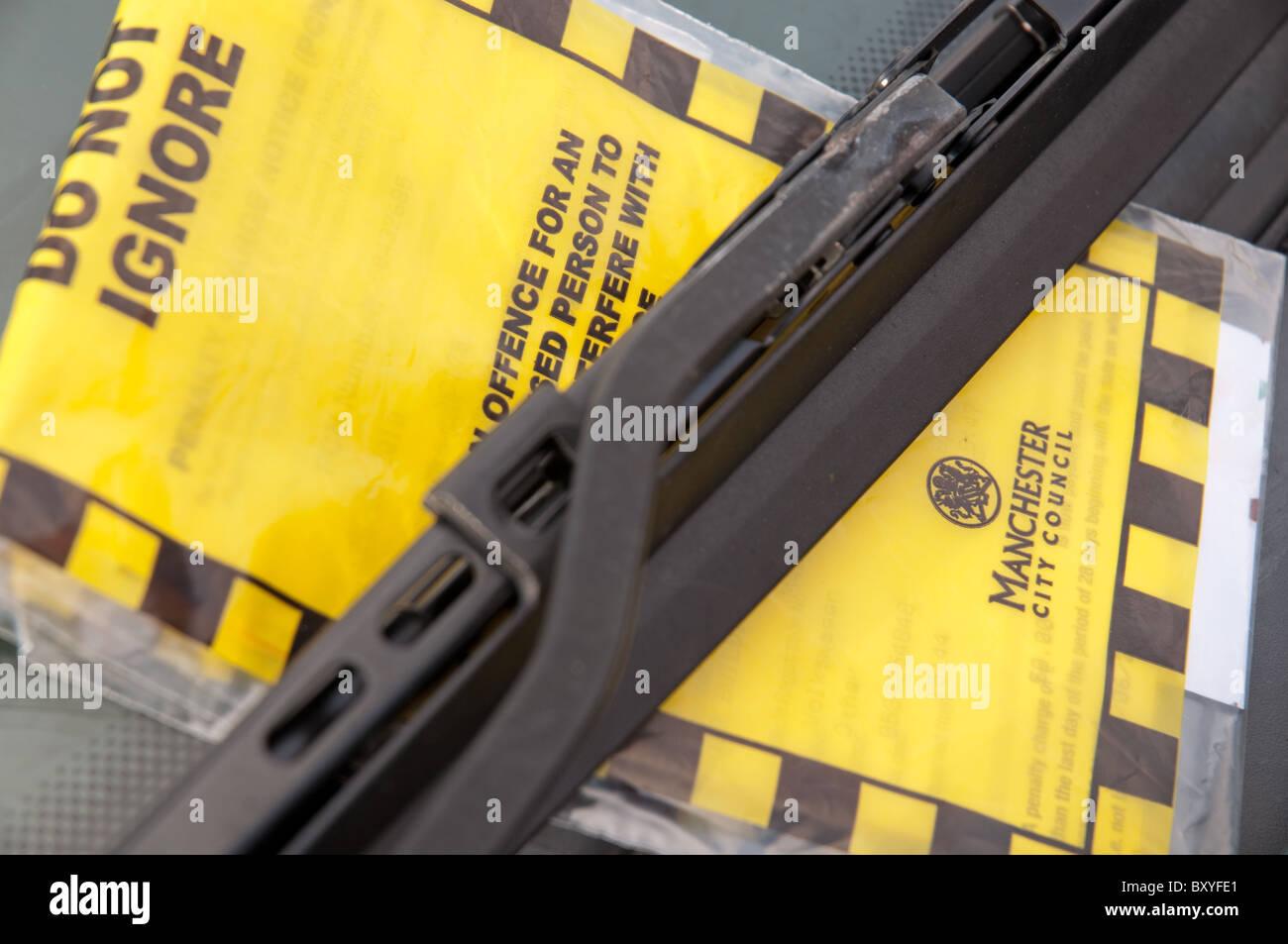 Parking ticket held under wiper blade.Manchester,UK. - Stock Image