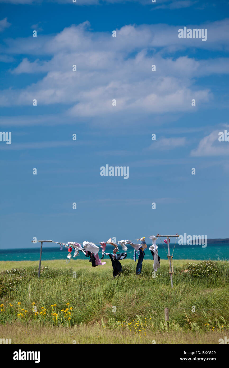 Washing drying in the wind by the coast in County Clare, West Coast of Ireland - Stock Image