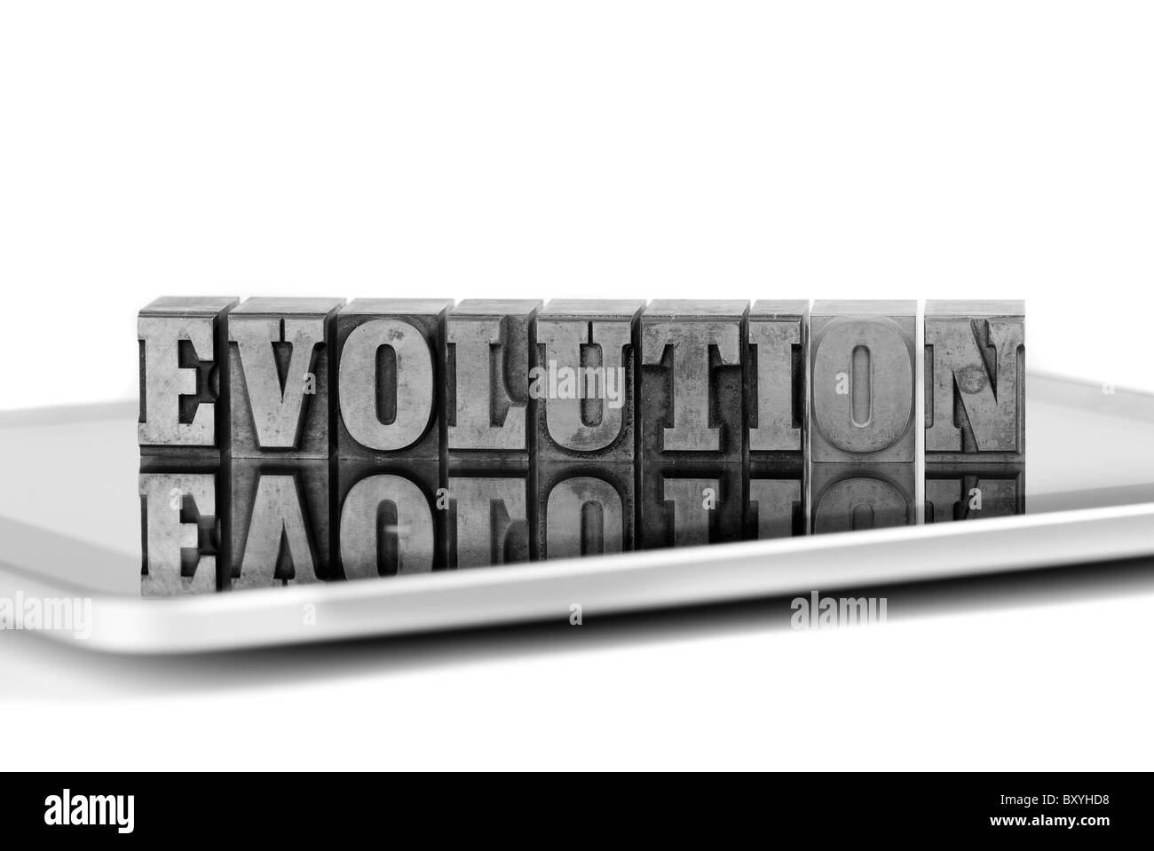 The word EVOLUTION in plumb letters on a tablet computer - Stock Image