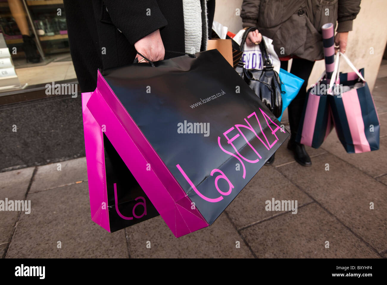 UK, England, Yorkshire, Leeds, City Centre, shoppers holding carrier bags full of Christmas shopping - Stock Image