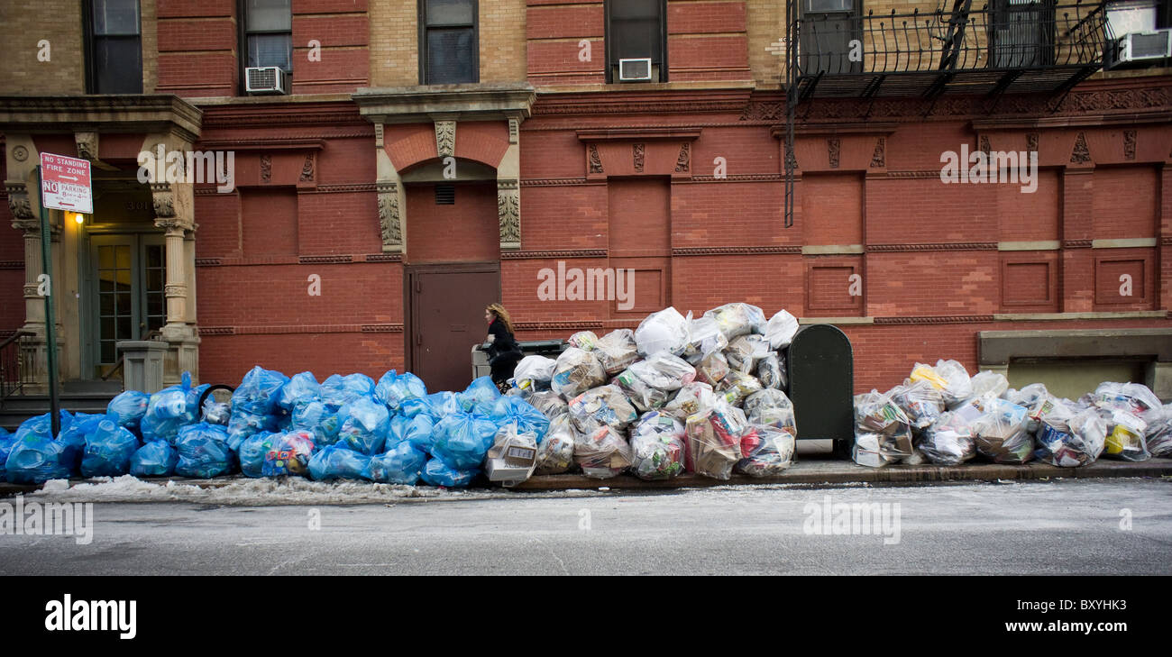 Bags of trash await pick-up in the Chelsea neighborhood of New York Stock Photo
