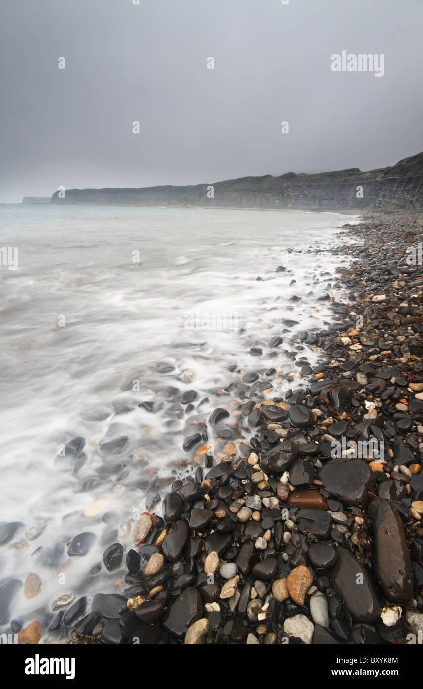 Dark clouds over the beach from Kimmeridge Bay - Dorset's Jurassic coast, England - Stock Image