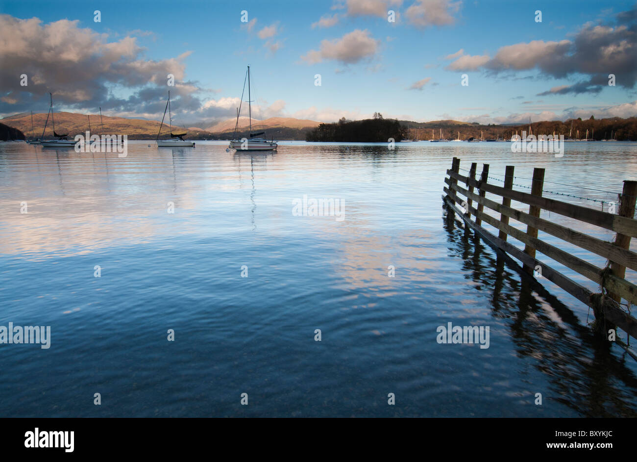 Evening light on a tranquil Lake Windermere in the Lake District, Cumbria England - Stock Image
