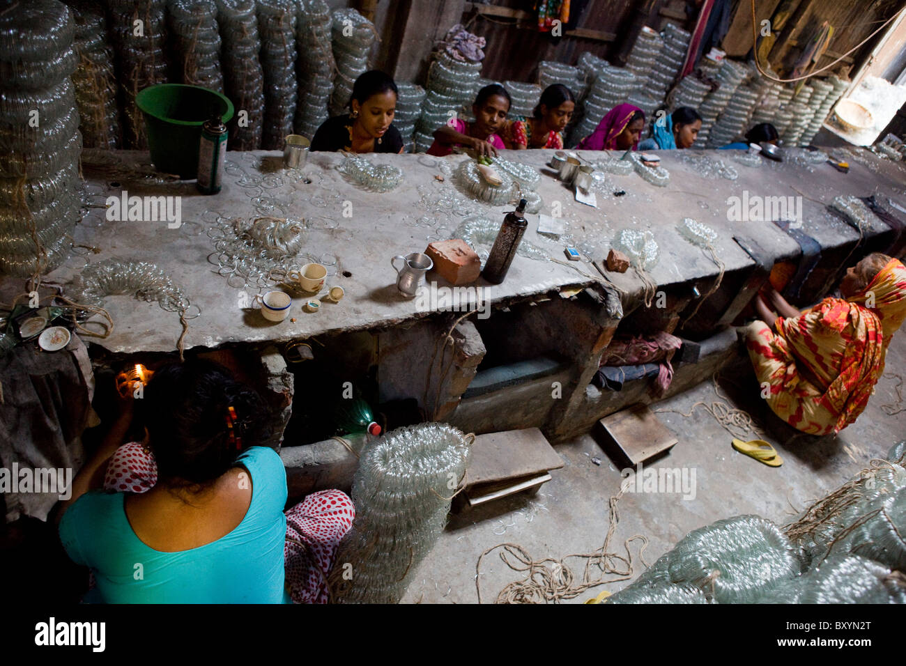 Women workers making bangles in a sweat shop in Old Dhaka, Bangladesh - Stock Image