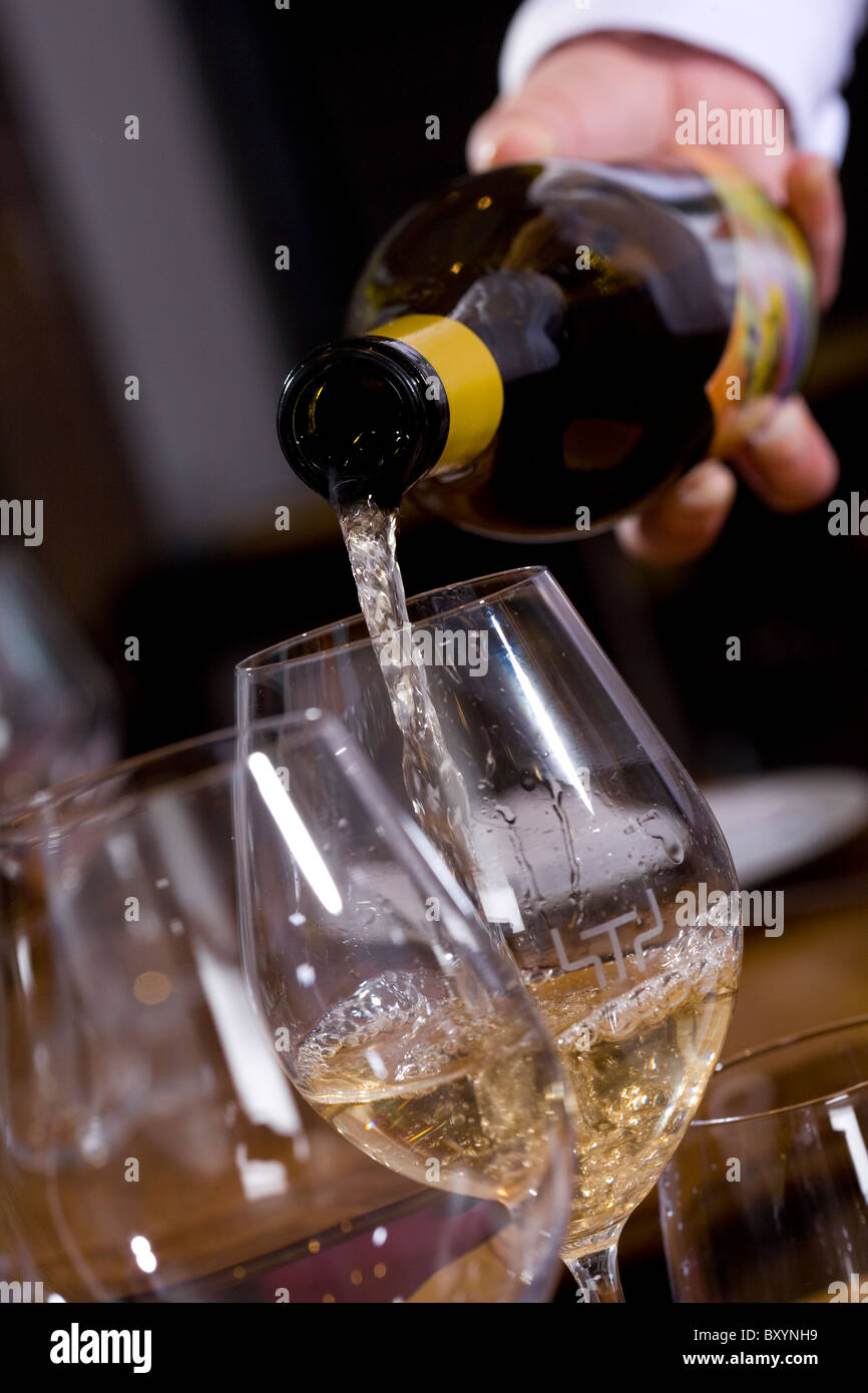 A glass of wine being poured at Fifteen restaurant, London - Stock Image