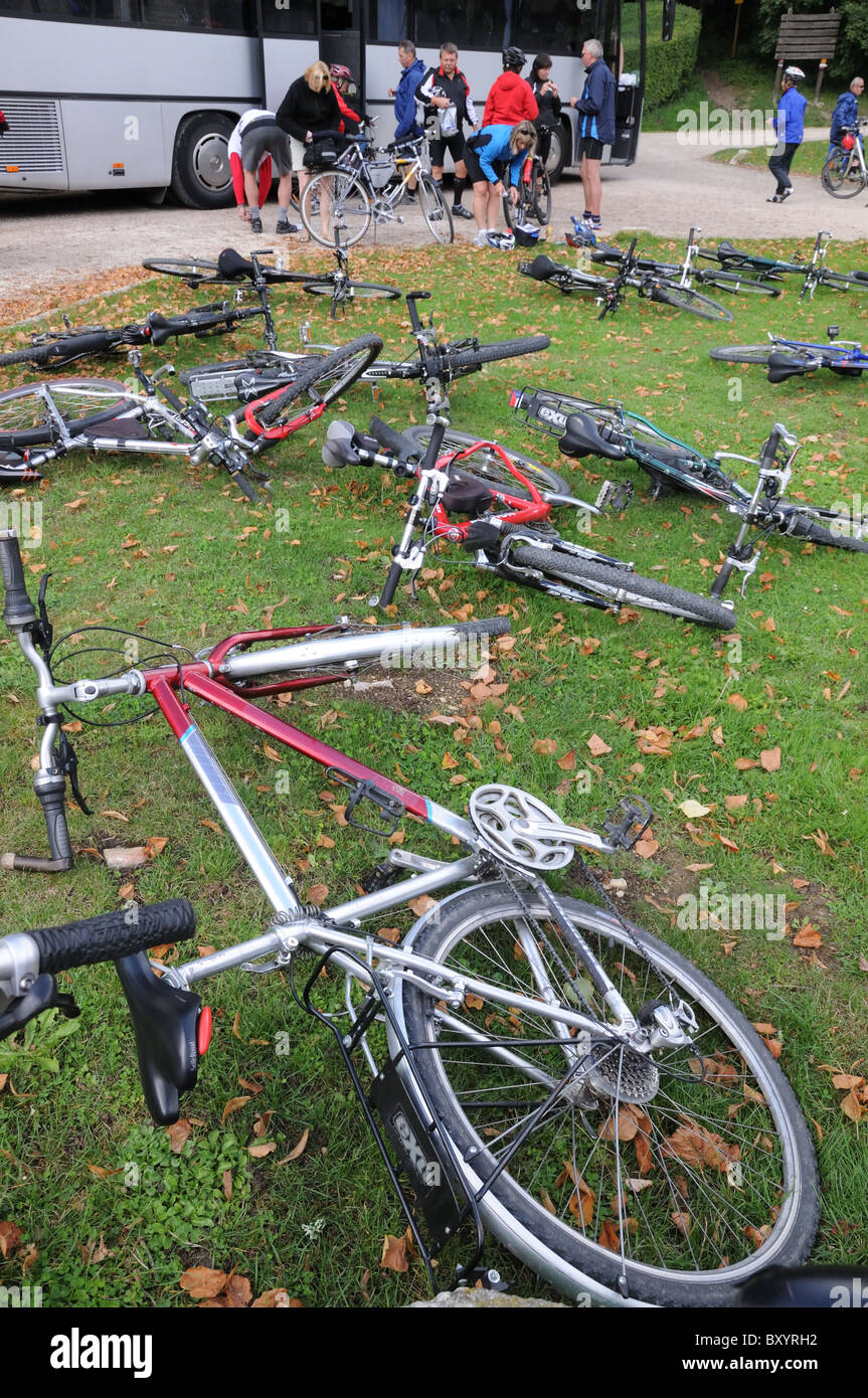Bicycles lying on the lawns outside the Abbaye de Fontenay Burgundy France BICYCLES BIKES CYCLES CLUB VISITORS - Stock Image